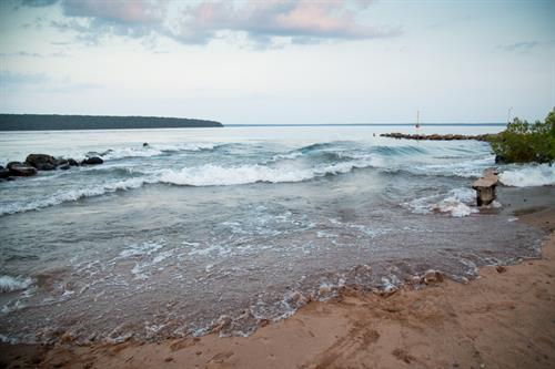 Follow the wooded trail creekside, and you're a short 10-minute stroll from the sandy, quiet, private Brickyard Creek Community beach on Lake Superior.