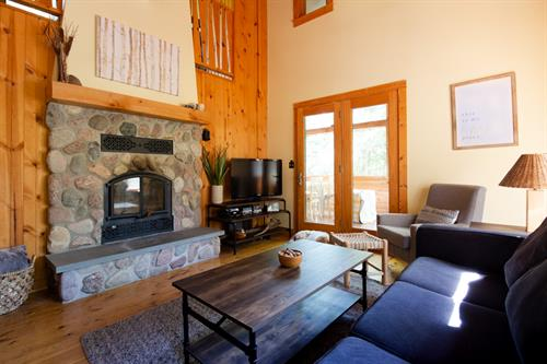 A beautiful, wood-burning, stone fireplace sets the stage in the large-windowed living room. In the winter, warm-up to the sound of a crackling fire after a day of skiing or snowshoeing.
