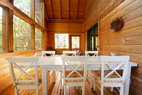 Enjoy the sounds of the forest as you have dinner or play cards on the rustic six-person dining table.