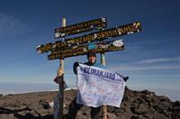 Lori Schneider summits Kilimanjaro for a second time in 2011.