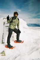 Lori Schneider on the summit of Mt. Kosciuszko, Australia's highest peak.
