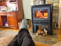 Relax in front of the wood stove on the chaise lounger