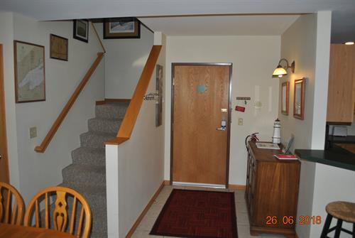 Main entrance door to condo.  Steps lead to 2nd level with Bedroom, bath, & two twin beds.