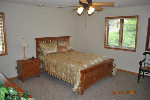 1st Level Queen Bed.  Large bedroom with Lake Views & 2 closets, dresser, night stand.