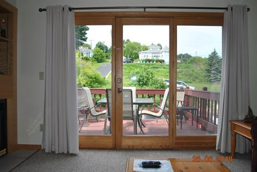 Large balcony off of Living Room with Table and 6 chairs. Looks out at Madeline & Basswood Islands.