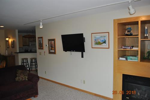 "40"" Roku Flat Screen TV in 1st Level Living room with 2 couches."