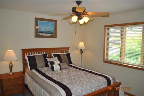 2nd Level Bedroom with Queen Bed, closets, and Lake Views.