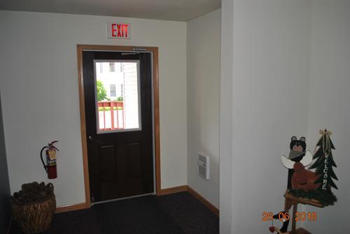 Back alley door to ramp, next to Condo #203 door.