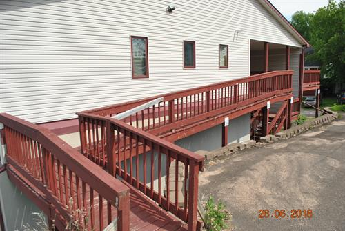 Back ramp to condo.  Key in condo. Main entrance is in parking lot below.
