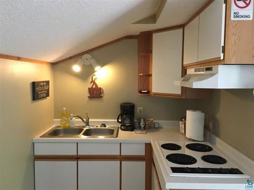 2nd Level Sevona kitchen with stove, sink, microwave, & refrigerator.