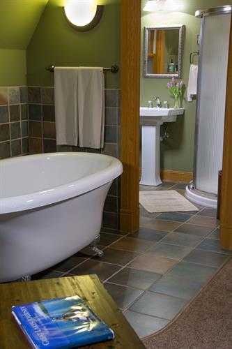 Large clawfoot jetted tub in Whispering Pines Room in our Garden House