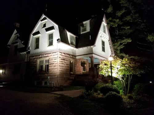 Night view of the historic brownstone house - they just don't make them like they use to!