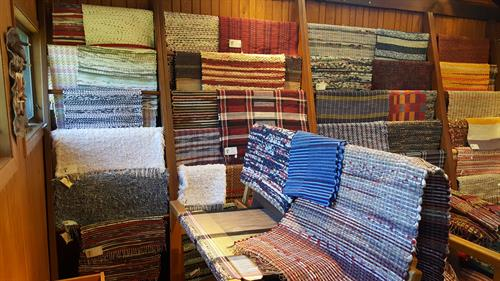 Extensive collection of local, hand-loomed rugs