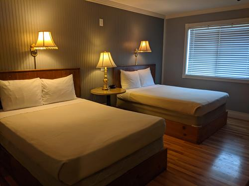 Lake Superior Lodge hotel unit with 2 full sized beds, private bathroom, private no-contact key-less entryways with private deck or patio