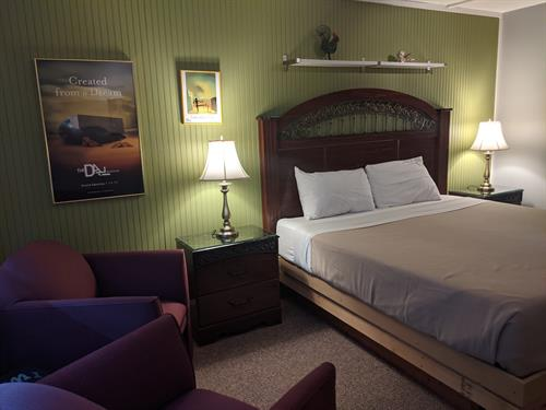 Lake Superior Lodge unit with 1 king sized bed, private bathroom, private no-contact key-less entryway with private deck or patio.