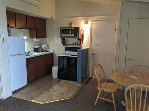 Madeline Island Suite with 1 bedroom, one private bathroom with jacuzzi, and kitchenette while overlooking beautiful Lake Superior from the over-sized deck
