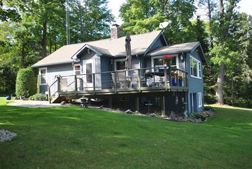 The Washburn Beach House Lake Side Deck and large lawn leading to beach.