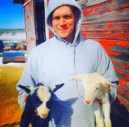 Fred Faye of Happy Hollow Creamery in Bayfield, WI is showing off some sweet young goats.