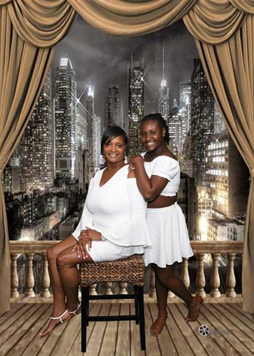 Family reunion/ All white affair with  a soft city backdrop...Mother and daughter