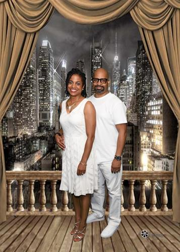 Family reunion/ All white affair with a soft city backdrop...Man and wife