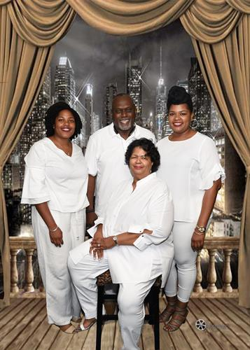 Family reunion/ All white affair with a soft city backdrop...Family portrait