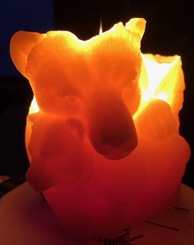 Bear Beeswax Candle while burning