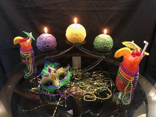 Fleur de Lis Beeswax Ball Candles in centerpiece for Mardi Gras
