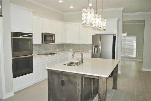 Gallery Image Riata_8502_Grand_Oaks-kitchen_view_2_(1200x803).jpg