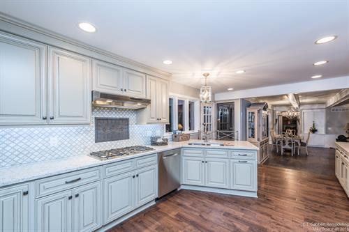 Creamy kitchen with peninsula