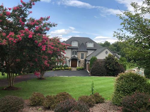 Nearly 7000 sqft., fabulous lake home at The Water's Edge Country Club!