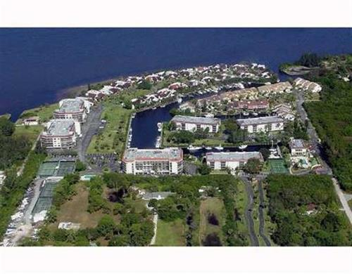 Gated & manned community of Emerald Pointe - condos, villas & townhomes, immediate boating access out and lots of amenities!