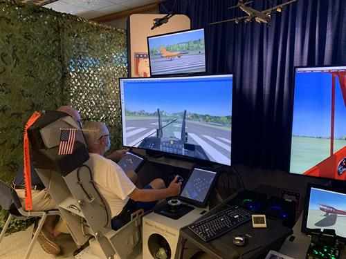 "Take off ""flying"" on one of the three flight simulators"
