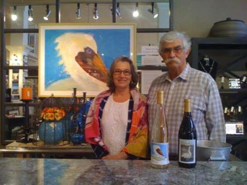 Wine tasting is offered during an Art Walk opening reception