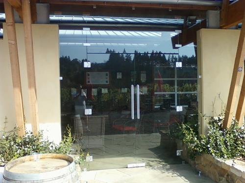 Commercial heavy glass doors, wind breaks and sliding glass walls