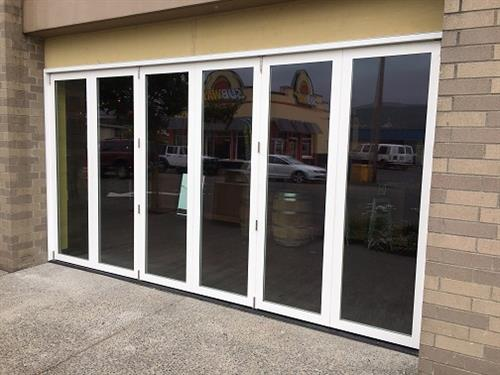 Custom Win-Dor sliding bi-fold doors for residential and commercial applications