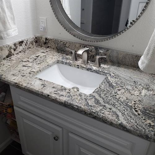 Upgraded master bath from laminate to granite with undermount sink & new faucet