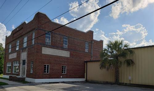 Historic Coca-Cola building and adjacent warehouse