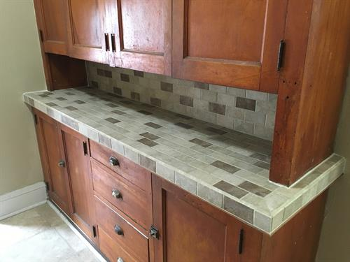 Old built in cabinet fixup. Tile countertop and backsplash.
