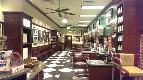 An upscale barbershop environment where you'll find great service and friendly, professional barbers.
