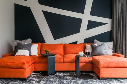 Bold and fun media room with custom blackout drapery