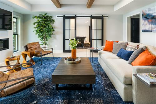 A vibrant basement design with industrial accents