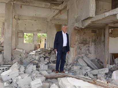 CSI's Dr. John Eibner in rubble of building in Middle East