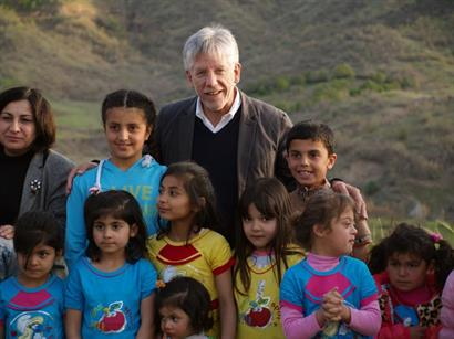 CSI's Dr. John Eibner with Middle East children