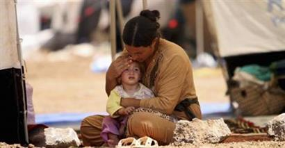Mother and child waiting for aid in Middle East