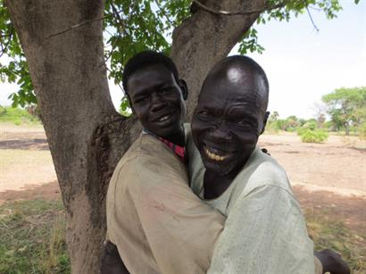 Father and son reunited after  being freed from enslavement near Darfur and taken home to South Sudan
