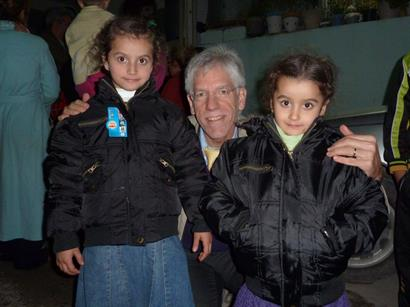 CSI's Dr. John Eibner - coat distribution in Middle East