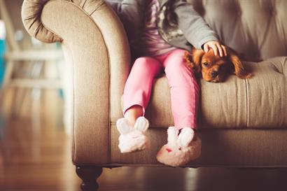 Gallery Image little_girl_with_dog_on_couch.jpg