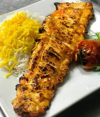Chicken Barg with Basmati Rice, topped with Saffron and a grilled tomato