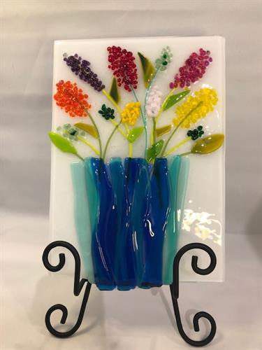 Fused glass flowers bloom all year.  This colorful piece demonstrates the great feelings glass brings!