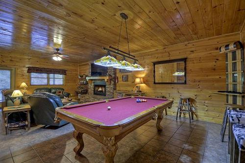 Many of our cabins have pool tables and other game tables